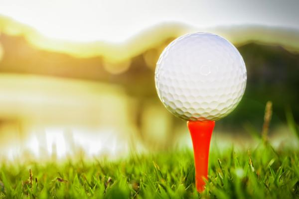 Close up of golf ball on tee against sunlight 624117394 3869x2579